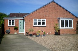 Composite door, A-rated double glazed windows, dry verge, gutters, fascia and soffit